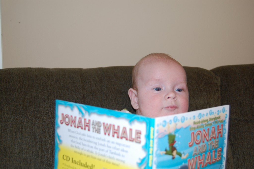 "Our son Johah ""reading"" Jonah and the whale at 3 months."